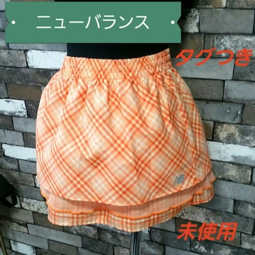 ニューバランス スカート オレンジ 白 チェック柄