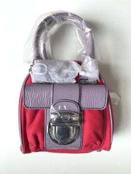 ディーゼル フラップポケット付き エナメルキャンバスミニバッグ