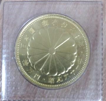 天皇陛下御在位60年記念十万円記念金貨幣