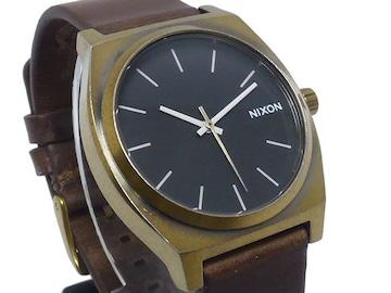 新品正規NIXONタイムテラーBRASS腕時計黒×茶2年保証有