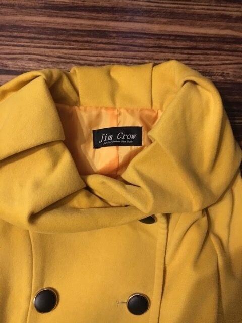 黄色 コート < 女性ファッションの